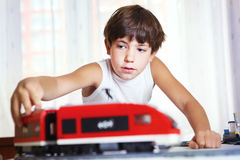Handsome boy play with meccano toy train Stock Photos