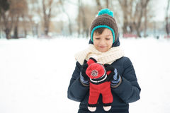 Handsome boy playing with a toy in the park in the winter in the Stock Photos
