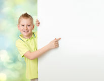 Handsome boy pointing to advertisement banner stock photo