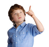 Handsome boy points with his finger. Isolated on Stock Image