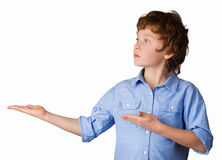 Handsome boy points with his hands. Isolated on Stock Images