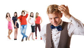 Handsome boy portrait with group of pretty girls Royalty Free Stock Image