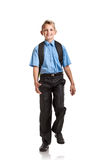 Handsome Boy with schoolbag marching Royalty Free Stock Photos
