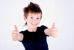 Handsome boy smiling holding two thumbs up Stock Photo