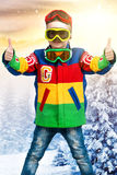 Handsome boy snowboarder in bright ski jacket and glasses.glasses stylecolor traffic light. Boy snowboarder in bright ski jacket and glasses royalty free stock images