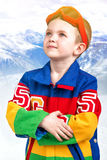 Handsome boy snowboarder in bright ski jacket and glasses. Little boy snowboarder.Sports stuff stock photos