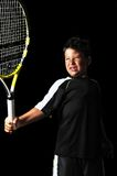 Handsome boy with tennis equipment playing backhand Royalty Free Stock Photography