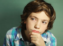Handsome boy think over difficult question. Preteen handsome boy think over difficult issue close up pprtrait royalty free stock image