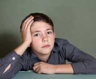 Handsome boy thinking on blue wall background Royalty Free Stock Photos