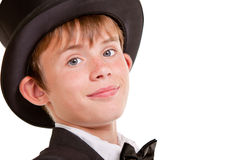 Handsome Boy in Top Hat Smiles at Camera. Close up Handsome Young Boy in Black Top Hat Smiling at the Camera Against White Background Stock Photos