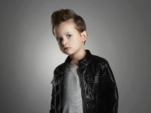 Handsome boy with trendy hairstyle.Fashionable child in leather coat Stock Photos