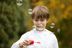 Handsome boy watching soap bubbles Stock Photo