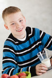 Handsome boy wearing milk mustache Stock Photography