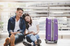 Handsome boyfriend and beautiful girlfriend take a rest and list stock photos