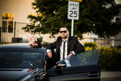 Handsome boyfriend in black suit waiting his girlfriend on street. Stock Images