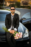 Handsome boyfriend in black suit waiting his girlfriend on street. Royalty Free Stock Photography