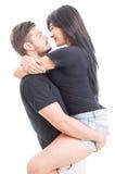 Handsome boyfriend holding happy girlfriend Stock Image