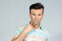 Handsome brazilian male wears colorful summer shirt. 30s. Handsome brazilian male wearing a colorful shirt. Summer, tropical. 30s. Fit and athletic Royalty Free Stock Images