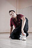 Handsome breakdancer sitting on the floor. Photo in dance studio royalty free stock photography