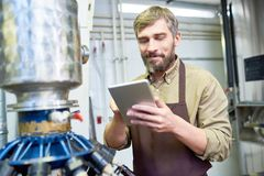 Handsome Brewer with Digital Tablet stock images