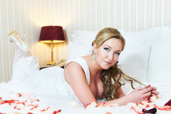 Handsome bride in bedroom hotel royalty free stock photo