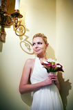 Handsome bride standing near lights candles Stock Photography