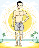 Handsome brunet man standing on tropical beach and wearing beach Stock Photo