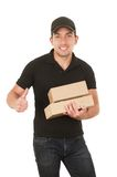 Handsome brunette courier man holding packages. Isolated on white royalty free stock photos