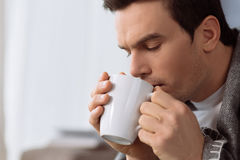 Handsome brunette man enjoying his tea Royalty Free Stock Photo