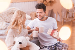 Handsome brunette man having tea with his girlfriend Stock Image