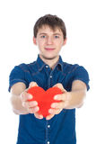 Handsome brunette mans holding a red heart, isolated on white background Stock Photos