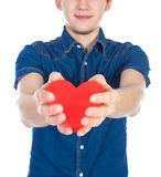 Handsome brunette mans holding a red heart, isolated on white background Royalty Free Stock Photos