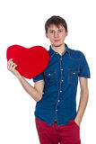 Handsome brunette mans holding a red heart, isolated on white background Royalty Free Stock Photo