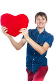 Handsome brunette mans holding a red heart, isolated on white background Stock Photography