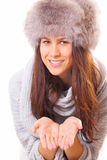 Handsome brunette woman in a fur hat Stock Image