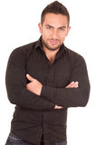 Handsome brunette young man posing wearing black Stock Photography