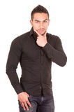 Handsome brunette young man posing wearing black Royalty Free Stock Image