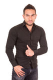 Handsome brunette young man posing wearing black Royalty Free Stock Photography
