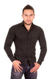 Handsome brunette young man posing wearing black Royalty Free Stock Photos