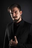 Handsome brutal guy with beard on dark background. In studio Royalty Free Stock Photography