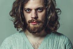 Handsome man with a beard and long hair. Creative portrait stock photos