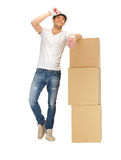 Handsome builder with big boxes Royalty Free Stock Image