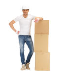Handsome builder with big boxes Stock Image