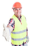 Handsome builder doing hand shake gesture Stock Photography