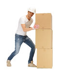 Handsome builder moving big boxes Stock Photography