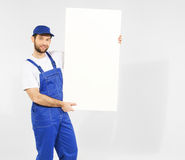 Handsome builder with white board Royalty Free Stock Image