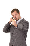 Handsome buisness man concentrated aiming a Royalty Free Stock Photo