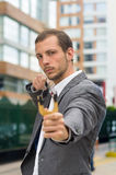 Handsome buisness man concentrated aiming a Stock Photo