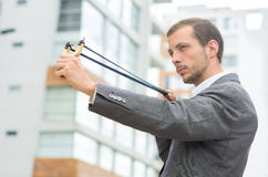Handsome buisness man concentrated aiming a Royalty Free Stock Photography