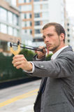 Handsome buisness man concentrated aiming a Stock Photography